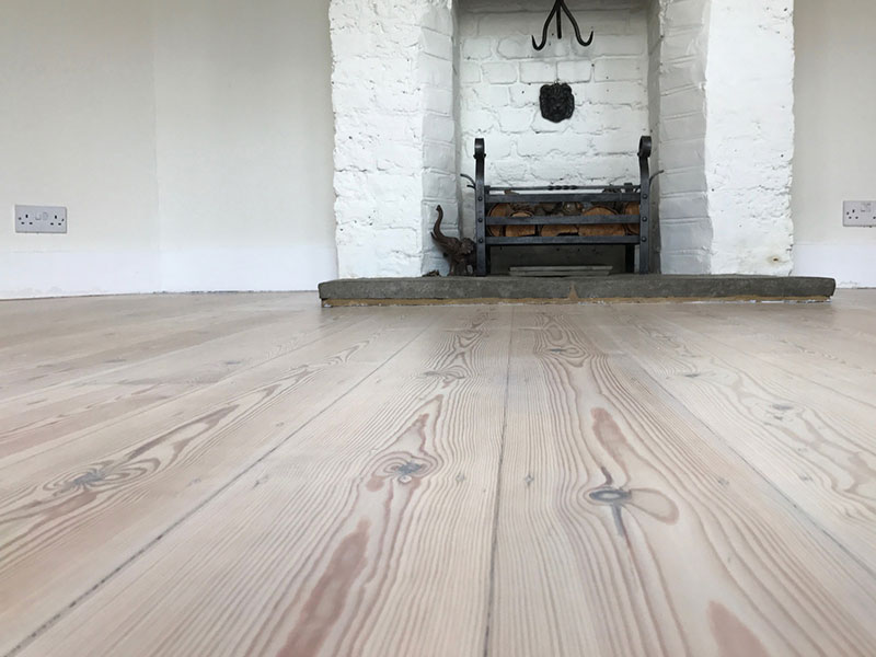 Original Pine floorboards transformed by chalky tones of liming hardwax oil